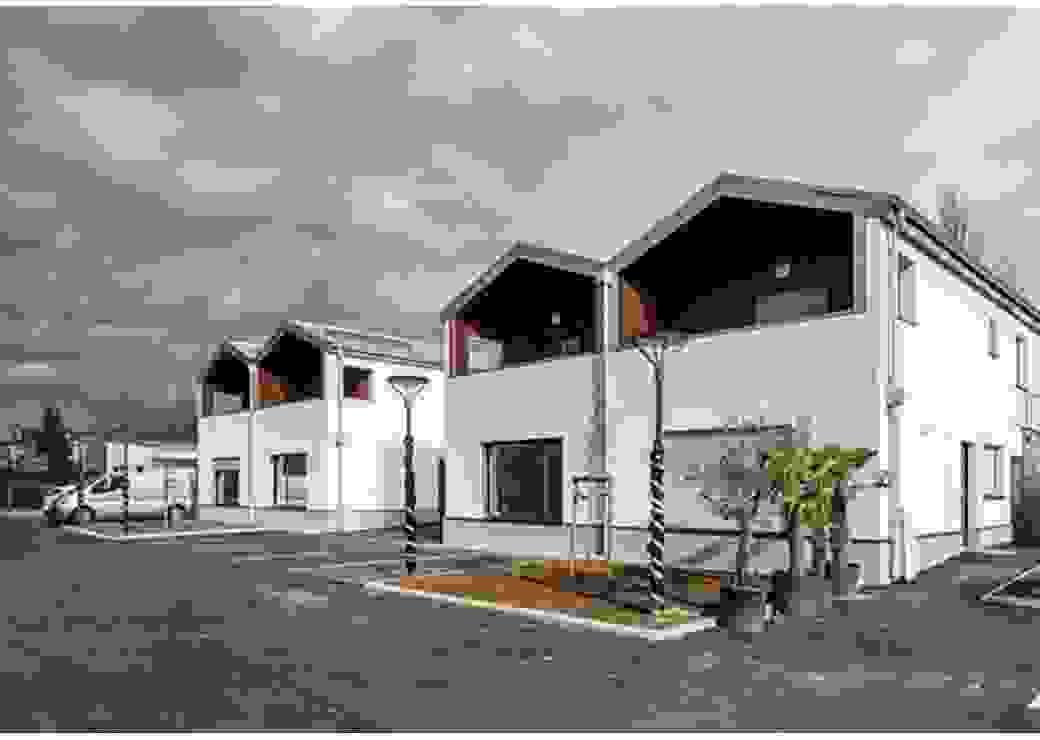 Plan large sur quatre maisons neuves