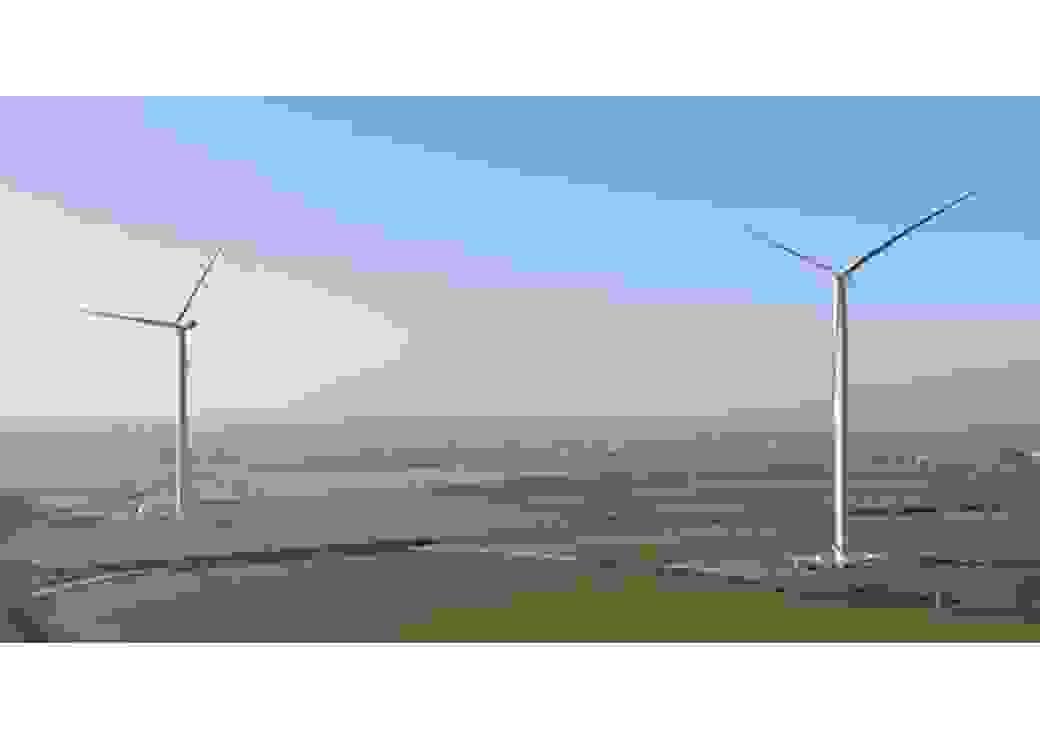 Vue aérienne d'un paysage vert où sont implantées deux éoliennes